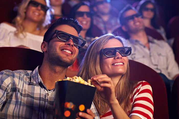 MOVIE GOERS WITH GLASSES ON